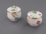 A pair of silver-gilt monted chantilly porcelain pots and covers